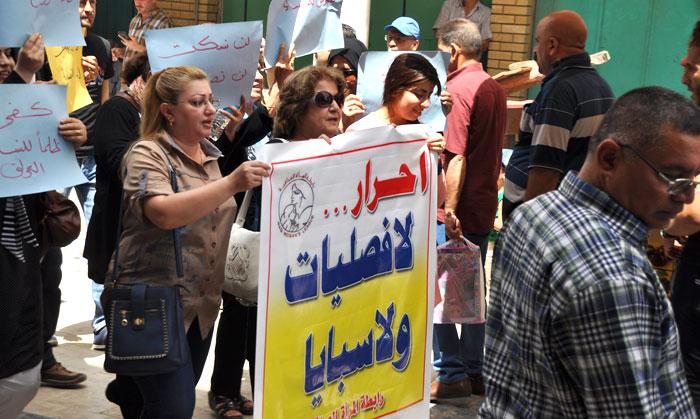 تظاهرة نسائية في شارع المتنبي اعتراضاً على زواج الفصلية
