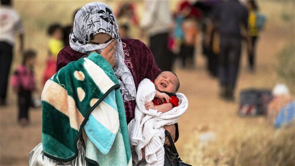 إمرأة لاجئة