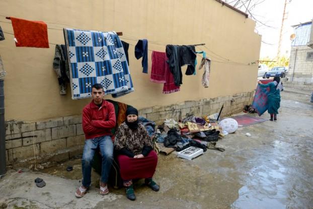 لاجئة سورية وابنها في صيدا بلبنان/ الأمم المتحدة