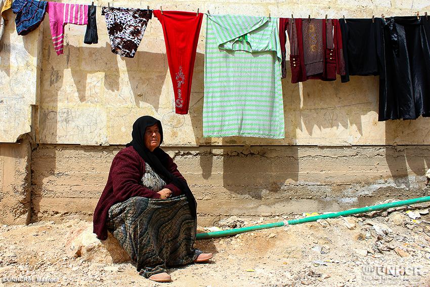 امرأة سورية نازحة