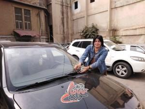 سيدة سورية تعمل في مغسل سيارات/ سناك سوري